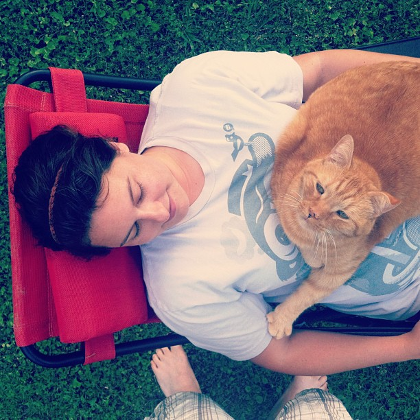Wife and cat chillin' in the backyard.