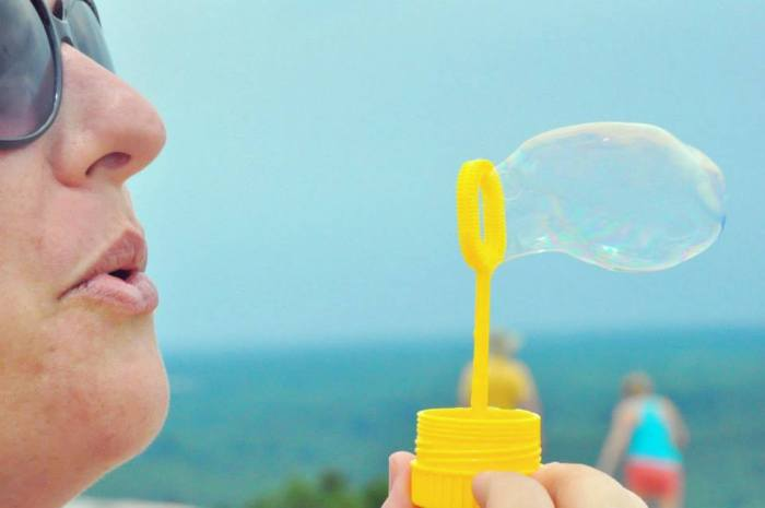 My wife blowing some bubbles on top of Stone Mountain on June 9.