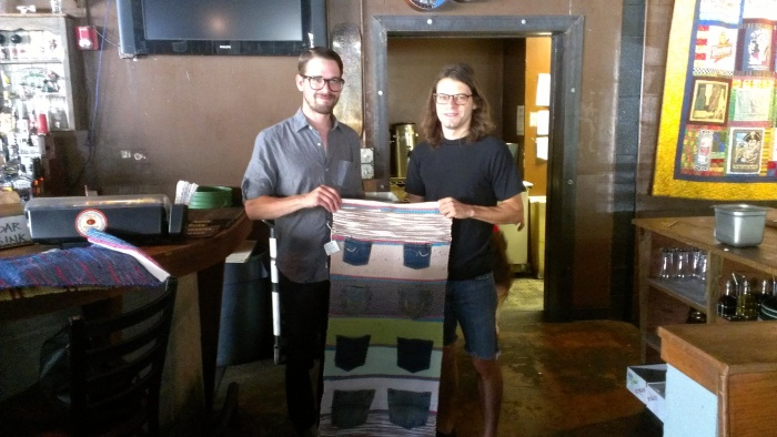 A couple of Twain's employees accepted re:loom's gift, a table runner made from recycled materials.