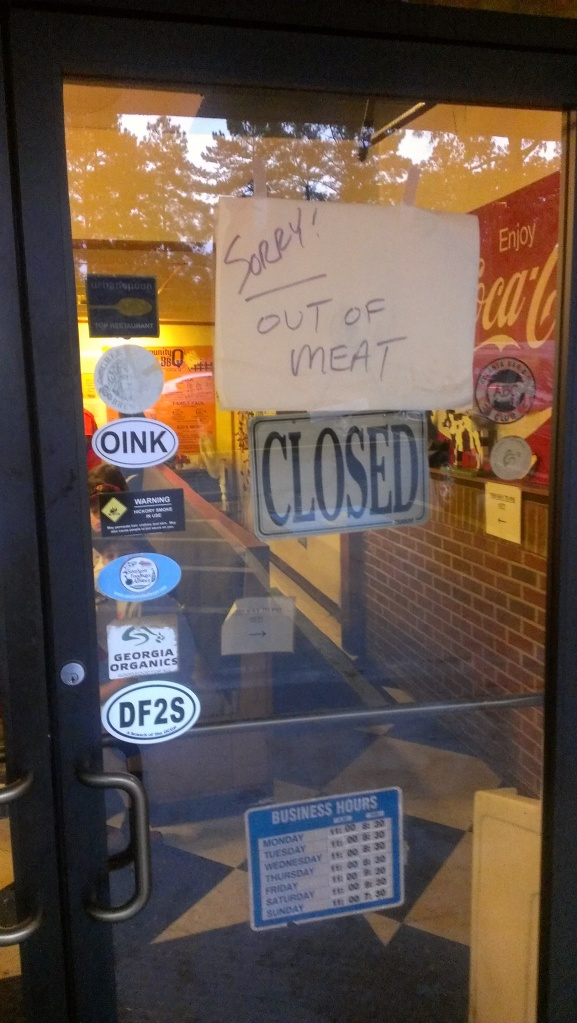 "Sign location: Community Q BBQ Purpose: Announcing victory. Grade: B+ Comments: The evil menace of cows and pigs is no more. The carnivores finally win one. FYI, there's ""meat"" 24-7 at McDonald's."