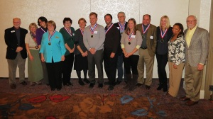 The 2013 Decatur Hometown Heroes with four city commission members. (Photo by Roger Easley)