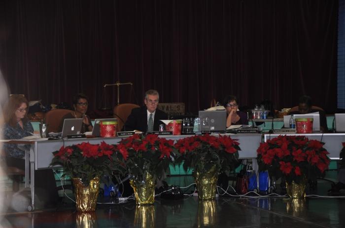Members of the Decatur, Ga. School Board listen to options for school attendance zones during a Dec. 10 meeting. Photo: Dan Whisenhunt
