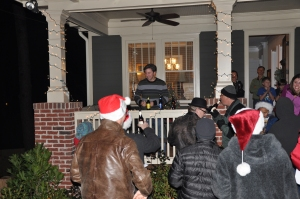 A Lenox Place resident thanks his caroling neighbors with the best Christmas gift ever: beer!
