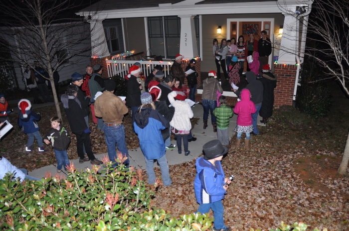 Lenox Place Neighborhood residents sing for one of their neighbors.