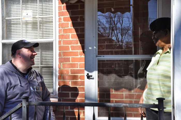 Paul Mitchell, chairman of the MLK Service Project, speaks to Carrie Evans, an Oakhurst resident, on Jan. 18. The three-day event helps elderly, low-income residents who have homes in need of repair. Photo by: Dan Whisenhunt