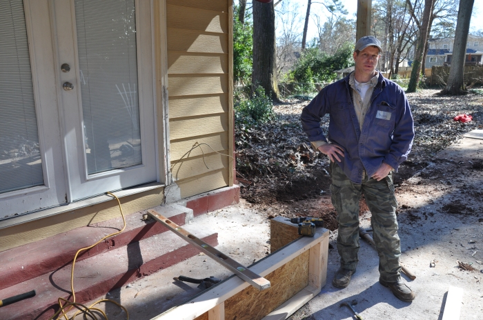 Jan. 18, 2014 Doug Thompson takes a break while building the wooden forms that will hold cement for a wheel chair ramp. Thompson has participated in the MLK Service project for seven years. Photo by: Dan Whisenhunt