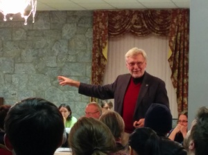 Architect Richard Taylor speaks to the Kirkwood Neighbors' Organization on Jan. 10, 2014, discussing his vision for redeveloping the Pratt-Pullman Train Yard.