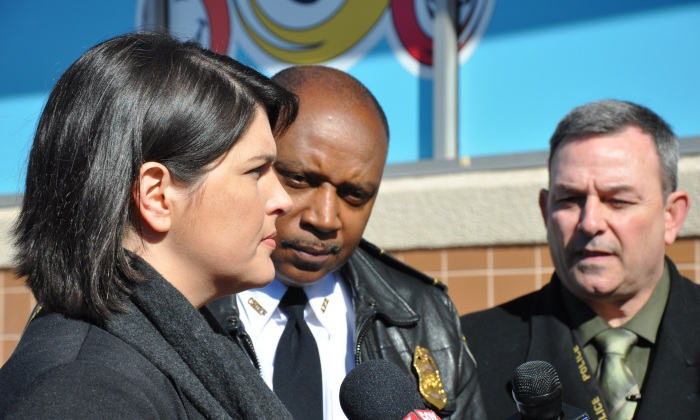 Kate Cotrona Krumm, sister of murder victim Patrick Cotrona, talks to the media on Jan. 16 as Atlanta Police Chief George Turner and Cpt. Capt. Paul Guerrucci listen. Krumm has raised money to place billboards around Atlanta seeking information about her brother's murder. Photo by Dan Whisenhunt